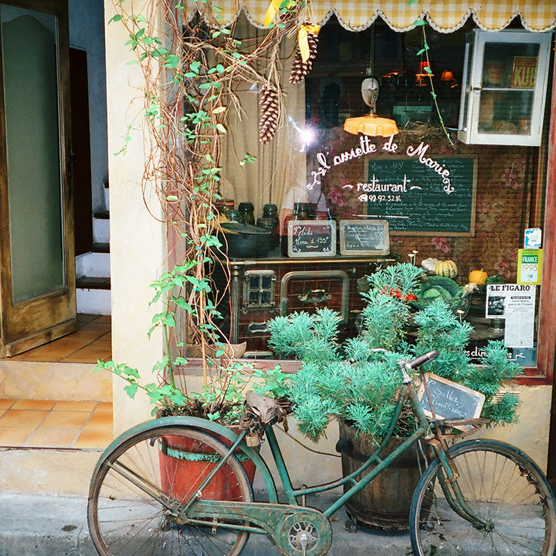 Bicycle by shop window in Provence