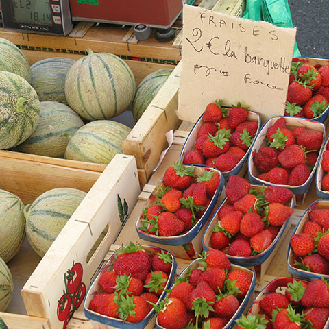 Market strawberries and melons